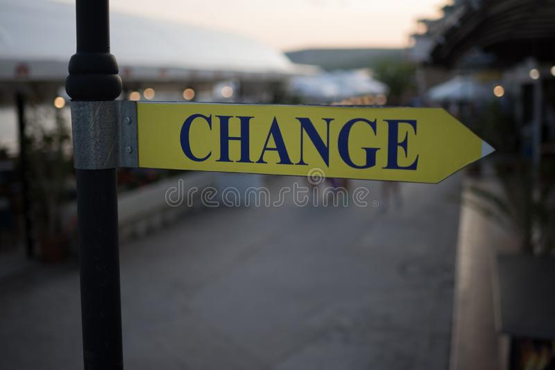 Street signboard `Change` on a blurred background. Concept: Time to change, Change the Way or a place to exchange money. Concept: Time to change, Change the Way royalty free stock images