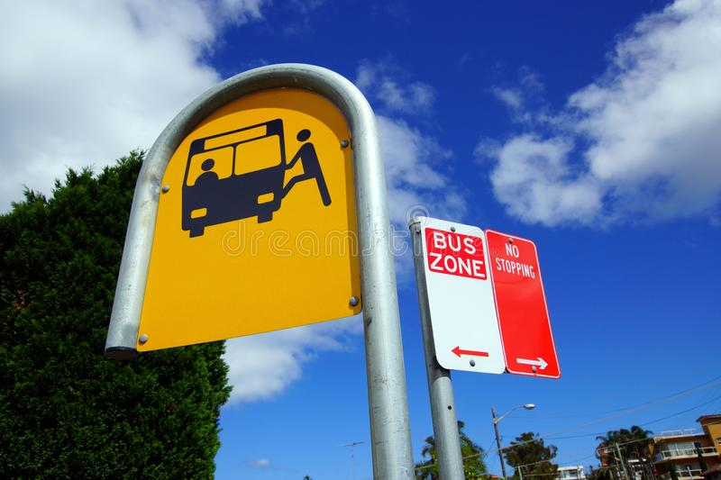 Bus Zone Street Signs. Street signs in a bus zone; bus stop, bus zone and no parking signs stock image