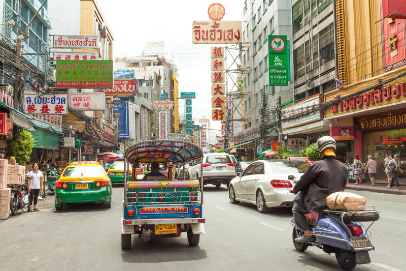 Street signs and cars ride in chinatown, Bangkok Thailand. Tuktuk, Street signs and cars ride in chinatown area of Bangkok Thailand stock images