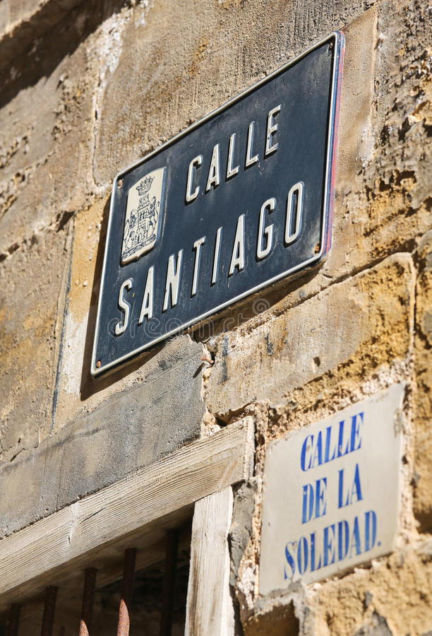 Street signs in the center of Haro, La Rioja, Spain. Street signs of the Calle Santiago (Santiago street) and Calle de la Soledad (street of loneliness) in Haro stock image