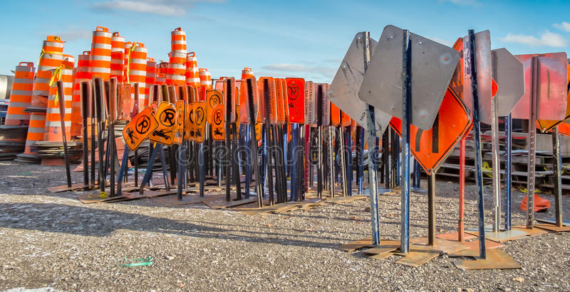 Street signs. Cone construction and street danger sign in a construction company yard stock photography