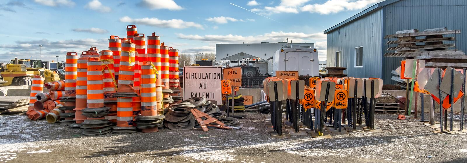 Street signs. Cone construction and street danger sign in a construction company yard stock image