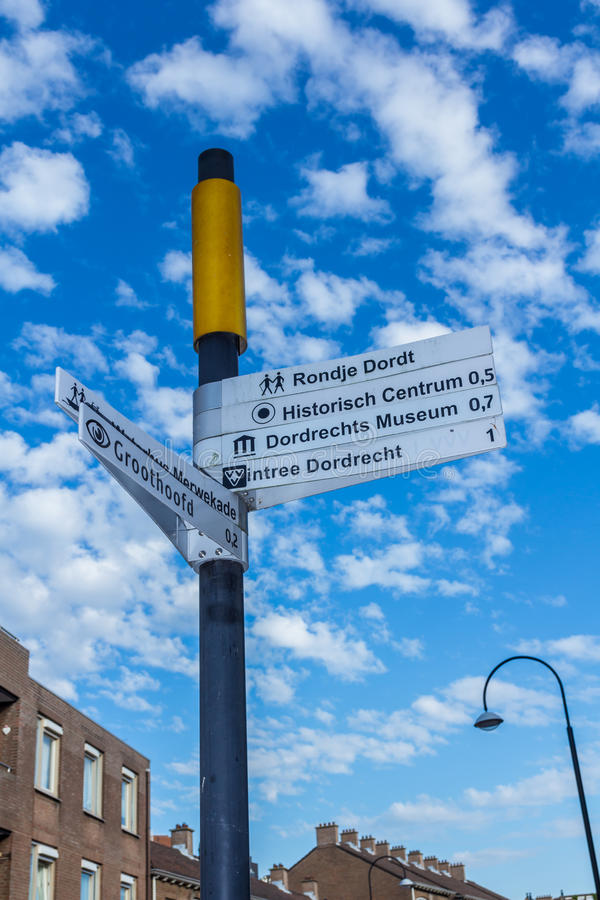 Street signs in Dordrecht, the Netherlands. Street signs in the historic center of Dordrecht, the Netherlands with bright blue sky stock image