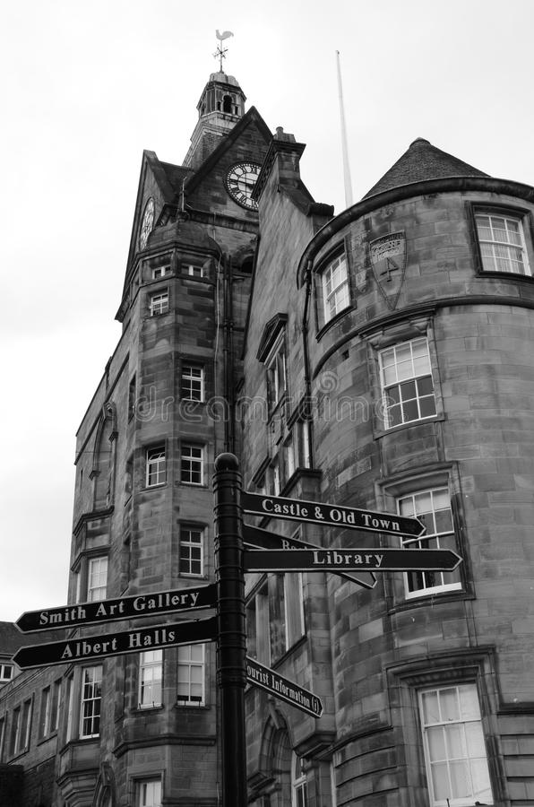 Street Signs. An external view of a towering clock tower and old style street signs in the old town of Stirling royalty free stock images
