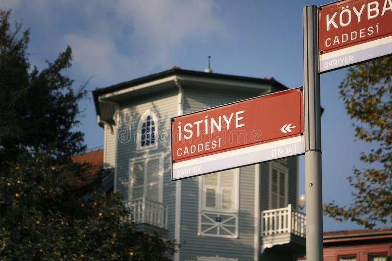 Street signs ICaddesi means Avenue. With old, wooden, historical house in Istanbul stock images