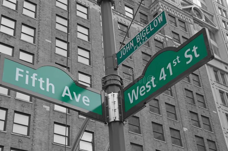 Street signs for John Bigelow Plaza in NYC. Street signs for Fifth Avenue, West 41nd street and John Bigelow Plaza in Manhattan (New York City). Color Splash royalty free stock photography