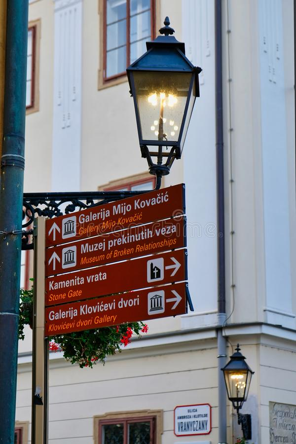 Street Signs and Light, Zagreb, Croatia. Street signs and a lit street light in the centre of historic Zagreb City, Croatia royalty free stock photos