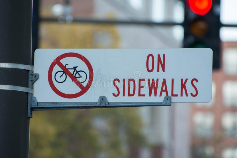 Street signs. No bikes on sidewalk stock images
