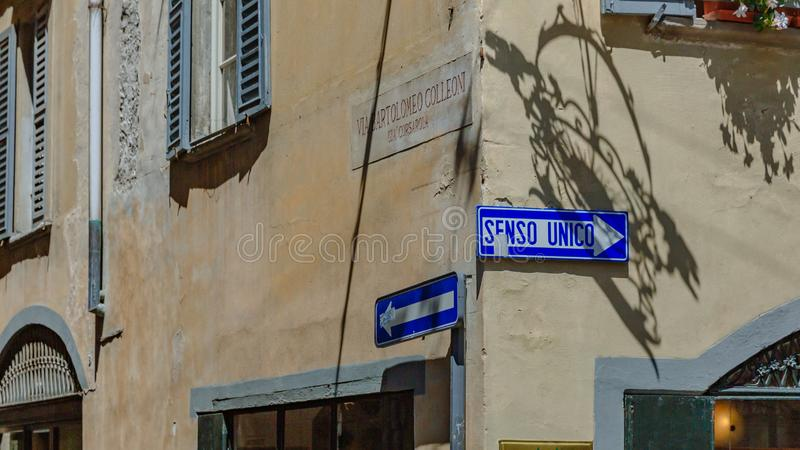 Street signs on old buildings in Bergamo, Italy. Buildings in Bergamo, italy, with street signs saying `one way road` and `Bartolomeo Colleoni street` in Italian stock photos