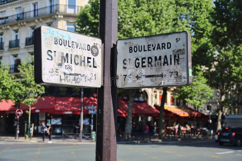 Street signs in Paris, France. Paris, France - May 19, 2018: Street signs of Boulevard Sait Michel and Saint Germain in Paris, France on May 19, 2018 royalty free stock images