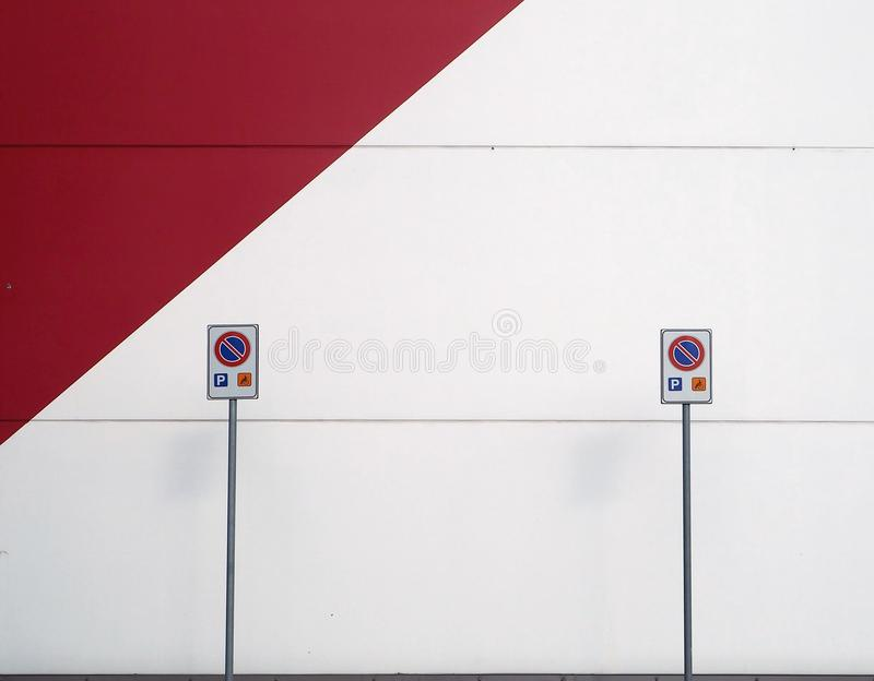 Street signs. On a red and white wall stock photography