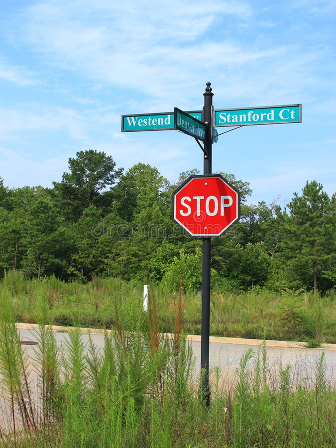 Street Signs And Stop Sign Stock Image