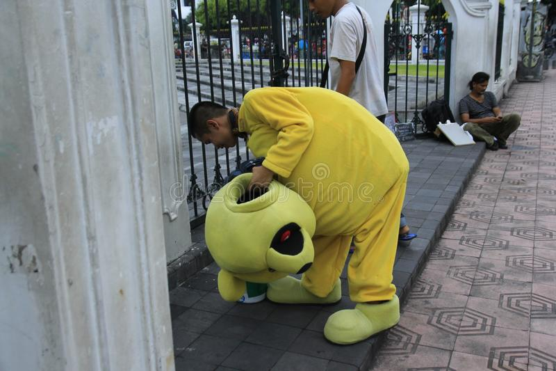 Street singers wearing cartoon characters take breaks stock photo