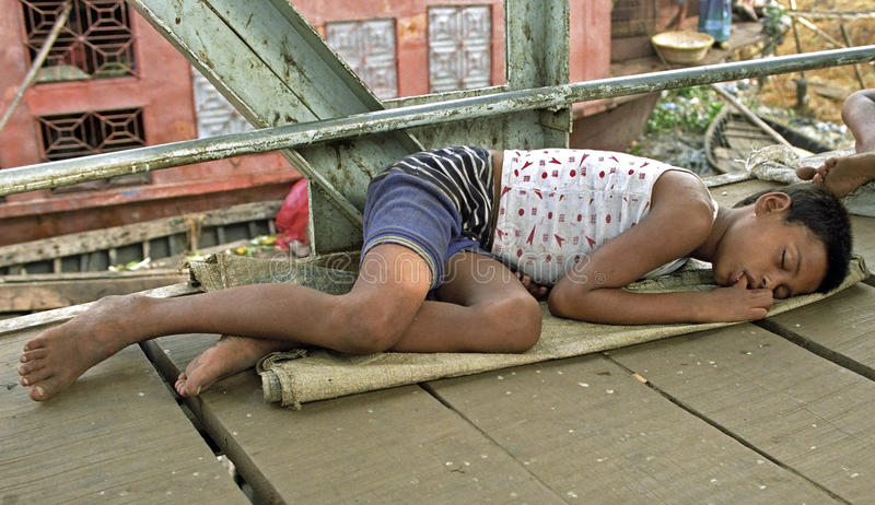 On the street sleeping homeless boy, street child royalty free stock photography