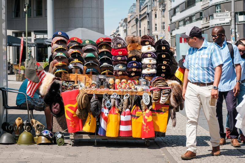 Street stall with souvenirs and socialist memorabilia from East Germany DDR       at landmark Checkpoint Charlie in Berlin royalty free stock photos
