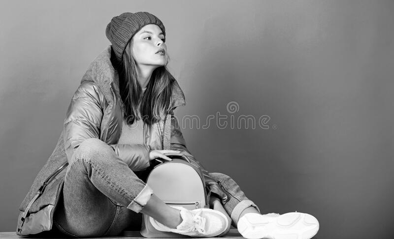 Street style. Girl wear fashion clothes. Look fashionable. Purposeful layering is perfect way to achieve warmth. Little. Backpack. Aesthetically pleasing style royalty free stock photography