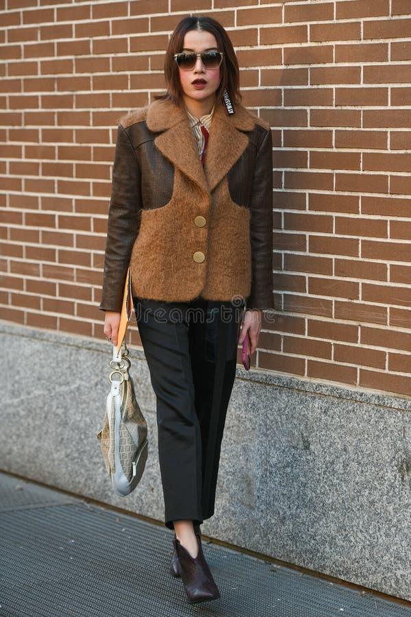 Street style during Milan Fashion Week Men`s royalty free stock image