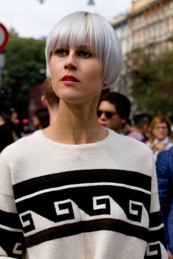 Street Style during Milan Fashion Week for Spring/Summer 2015. September 2014: Linda Tol spotted on the streets of Milan during Fashion Week for Spring/Summer royalty free stock image