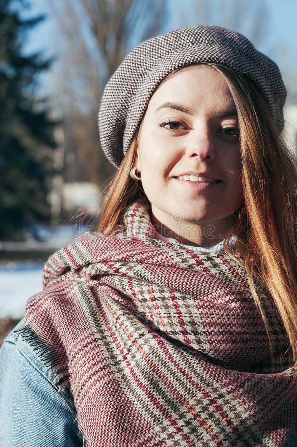 Street style portrait beautiful girl in winter clothes stock photography