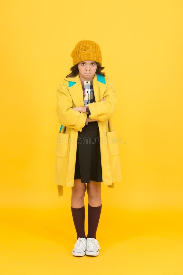 Street style. Rebel teen girl. Madcap concept. Teen age. Girl adorable stylish modern teenager. Cool schoolgirl. Have. Fun charismatic girl on yellow background royalty free stock photo