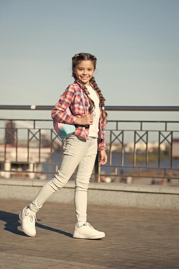 The street style way. Little cute child with beautiful long braided hair style. Adorable small girl in casual style on royalty free stock photography