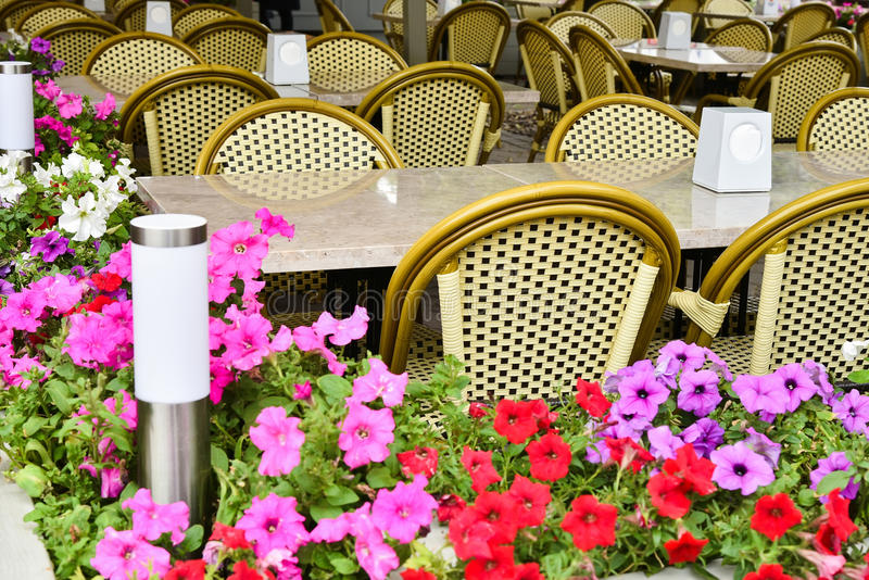 Street summer cafe with wicker furniture. stock photos