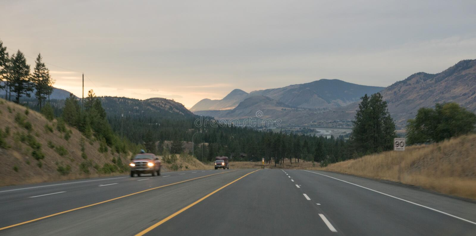 Street at sunset on road trip, mountain range around kamloops, Canada in fall. Street at sunset on road trip, mountain range around kamloops, Canada british stock images