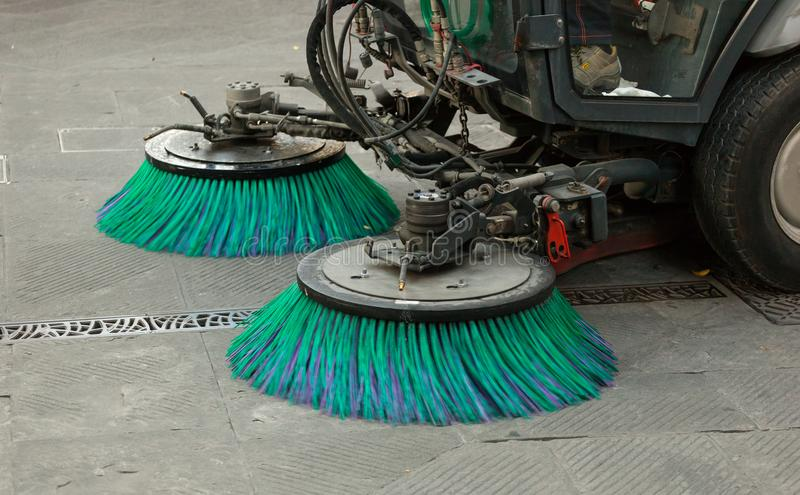 Street sweeper machine cleaning the streets stock image
