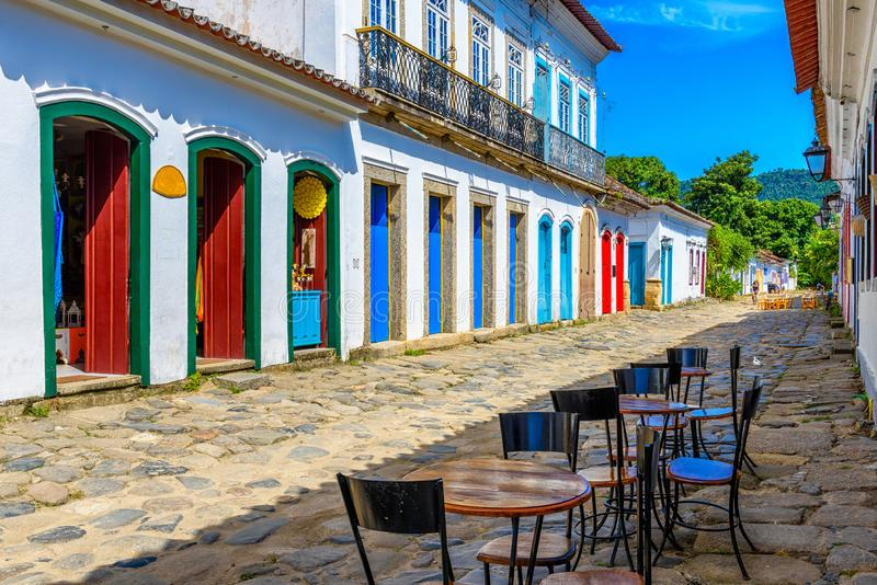 Street with tables of cafe in historical center in Paraty, Rio de Janeiro, Brazil. Paraty is a preserved Portuguese colonial and Brazilian Imperial stock photo