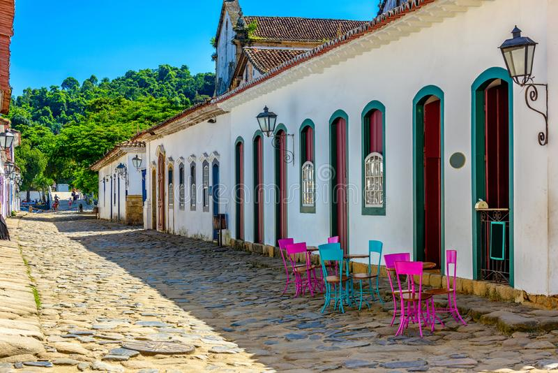 Street with tables of cafe in historical center in Paraty, Rio de Janeiro, Brazil. Paraty is a preserved Portuguese colonial and Brazilian Imperial royalty free stock images