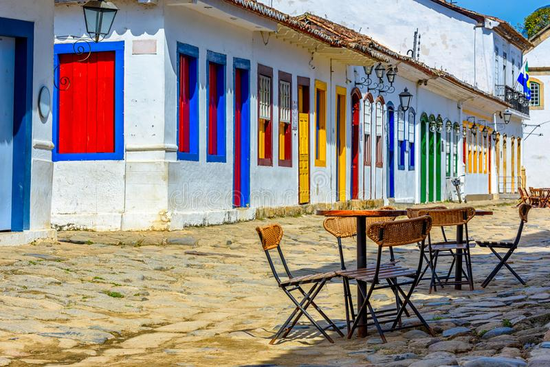 Street with tables of cafe in historical center in Paraty, Rio de Janeiro, Brazil. Paraty is a preserved Portuguese colonial and Brazilian Imperial royalty free stock photo