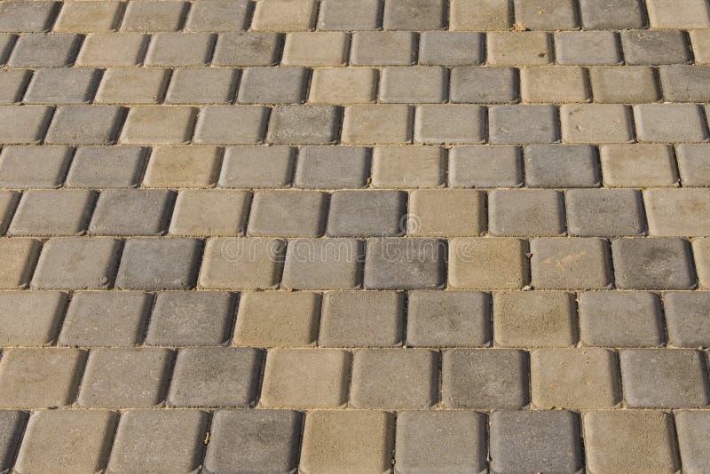 Street texture or background. Cobblestone pavement. stock photos
