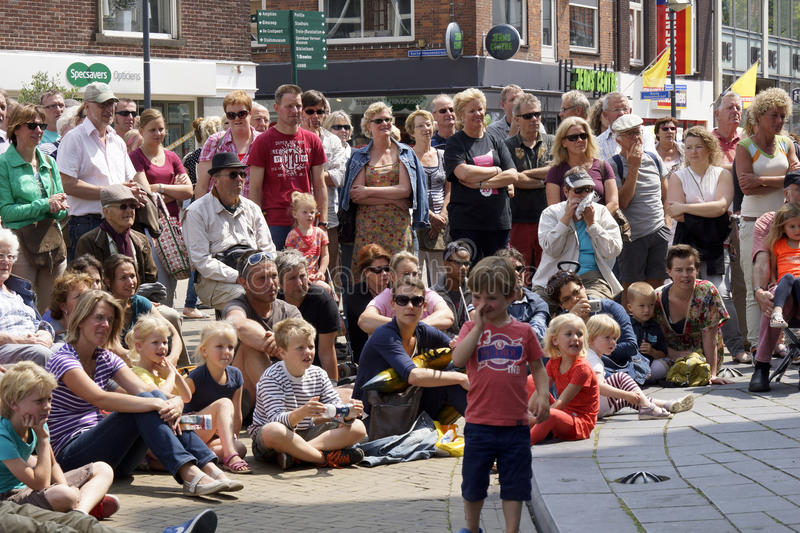 Street theater festival in Doetinchem, The Netherlands on July 1. Audience at street theater festival Buitengewoon in Doetinchem in the Netherlands in July 2013 stock image