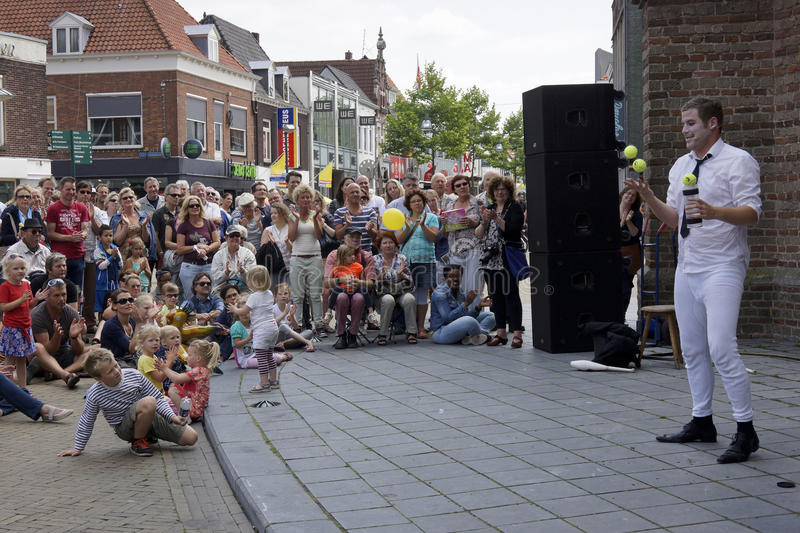 Street theater festival in Doetinchem, The Netherlands on July 1. Magician performing at street theater festival Buitengewoon in Doetinchem in the Netherlands in royalty free stock photography
