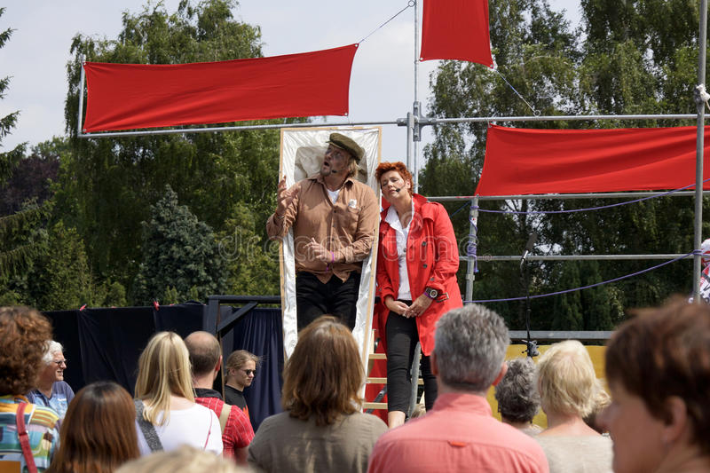 Street theater festival in Doetinchem, The Netherlands on July 1. People performing at street theater festival Buitengewoon in Doetinchem in the Netherlands in stock photo