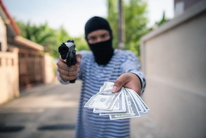 Street thief aimed a gun to tourist victim to attack robbery, Cr stock image
