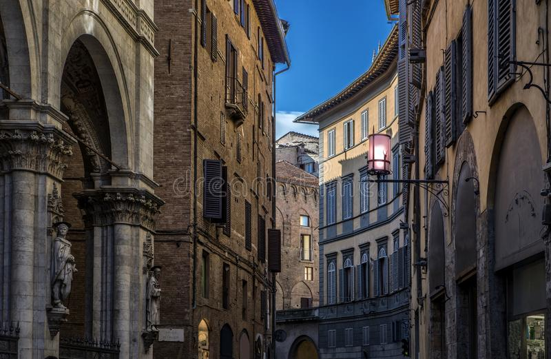 Street in siena with tipical italian arhitecture royalty free stock photos