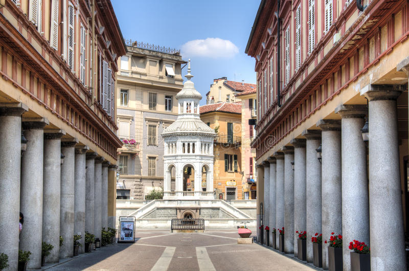 Street to fountain in Acqui Terme, Italy. Street with historic columns leading to the main square in Acqui Terme in Italy royalty free stock photos