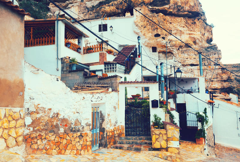 Street at town with dwelling houses into rock. Alcala del Jucar. Castile-La Mancha, Spain stock images
