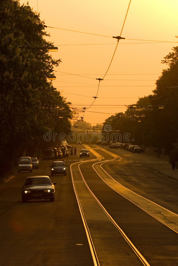 Street with tracks at sunset