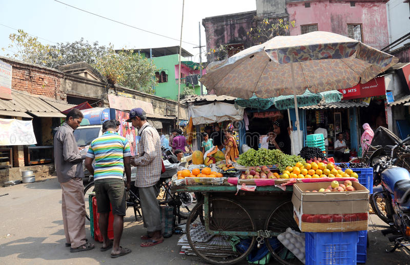 Street trader sell fruits in Kolkata India. Street trader sell fruits outdoor in Kolkata India. Only 0.81% of the Kolkata`s workforce employed in the primary royalty free stock image