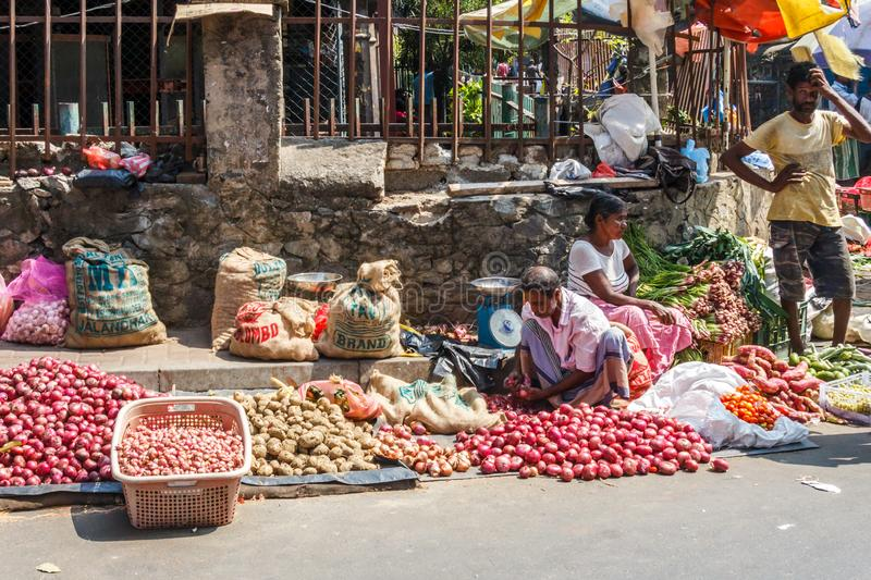 Street traders selling vegetables stock photography
