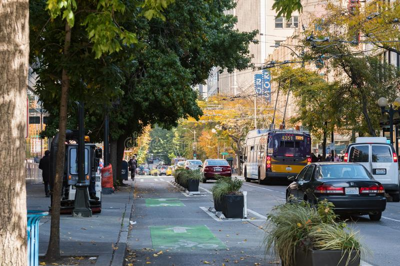 Street with traffic and bus in downtown Seattle stock image