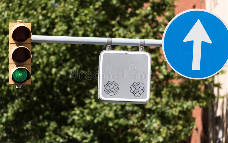 Street traffic signs and traffic light in Barcelona town, Spain.  stock photo