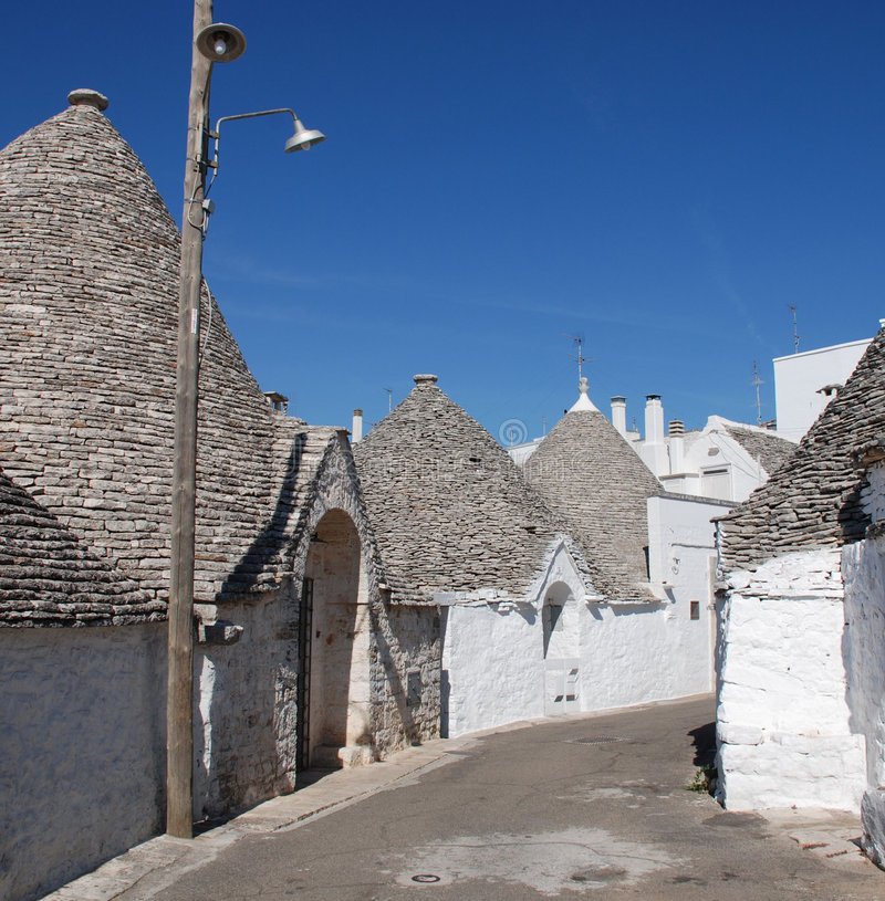 Street of Trulli 5. A street of trulli in Alberobello in Puglia, southern Italy. The trulli, which are protected under UNESCO World Heritage laws, are stock images