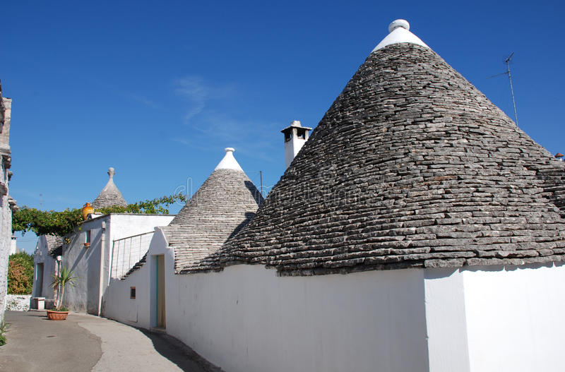 Street of Trulli. A street of trulli in Alberobello in Puglia, southern Italy. The trulli, which are protected under UNESCO World Heritage laws, are traditional stock image