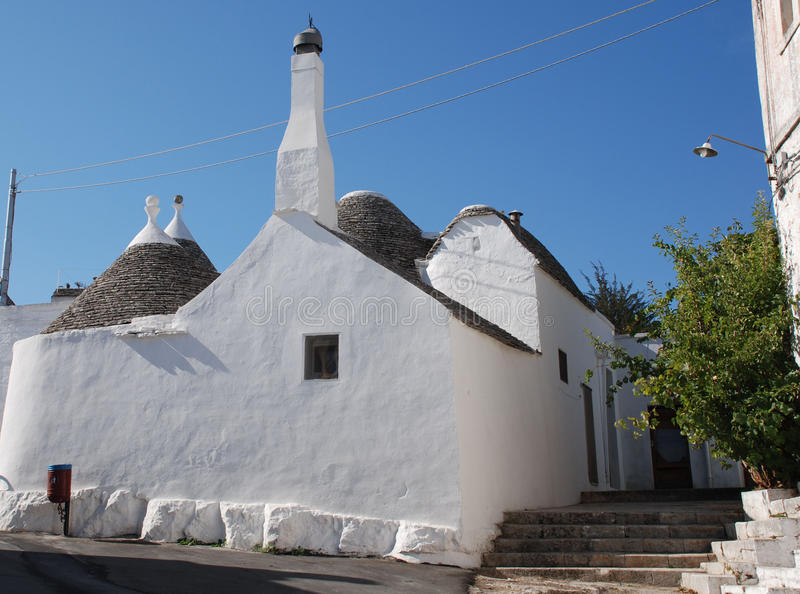 Street of Trulli, Alberobello. A street of trulli in Alberobello in Puglia, southern Italy. The trulli, which are protected under UNESCO World Heritage laws, are royalty free stock photography