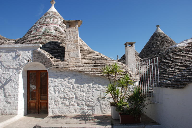 Street of Trulli, Puglia. A street of trulli in Alberobello in Puglia, southern Italy. The trulli, which are protected under UNESCO World Heritage laws, are stock photos