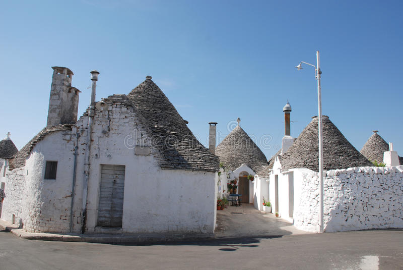 Street of Trulli in Puglia. A street of trulli in Alberobello in Puglia, southern Italy. The trulli, which are protected under UNESCO World Heritage laws, are royalty free stock images