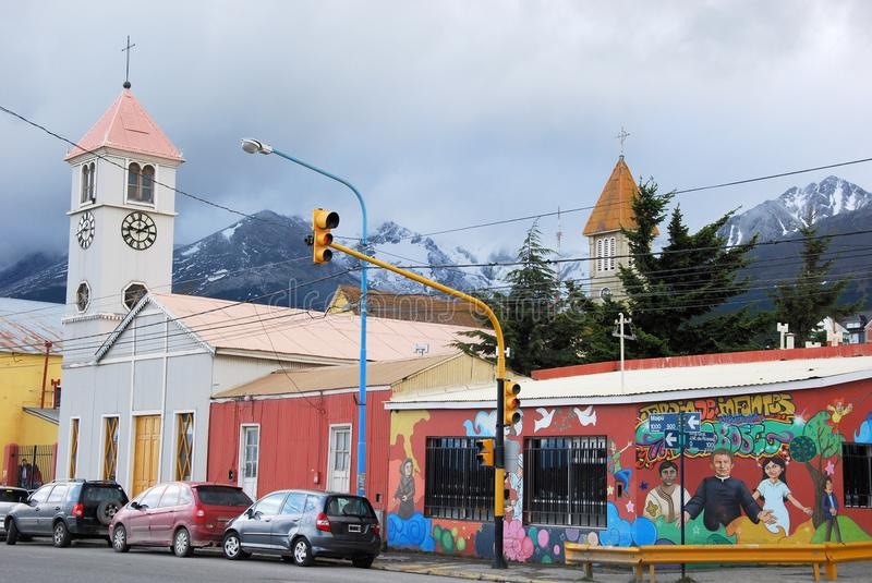 Street Ushuaia with 2 churches, Graffiti wall, Argentina. Street Ushuaia with 2 churches, graffiti wall, dark clouds, southernmost city in the world, capital of stock photo